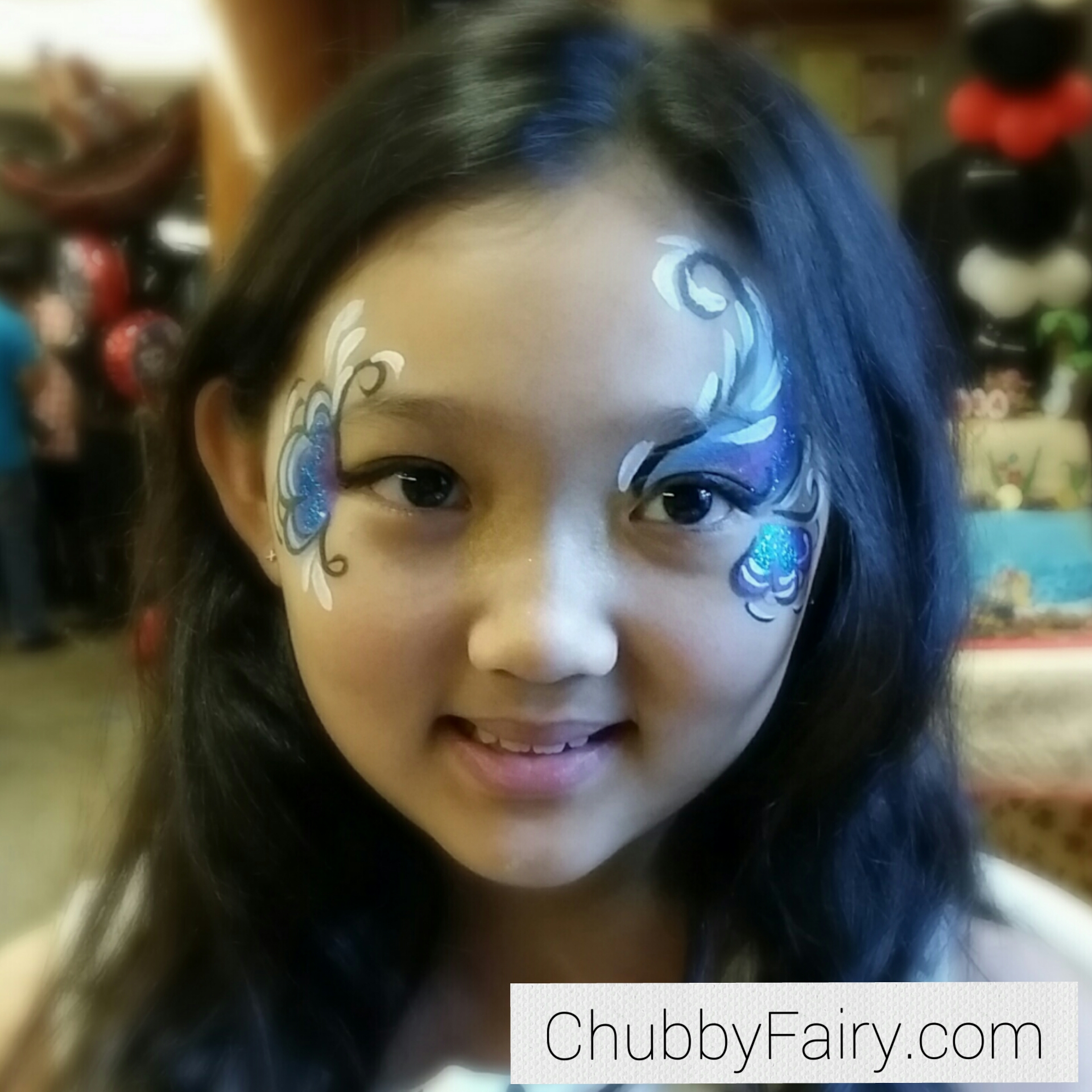 mermaid theme face painting for a preteen/teenage girl